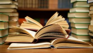News and Insights at i4di open books stacked books