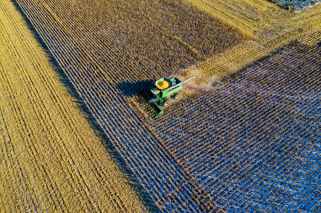 Corporate Sustainability aerial-photo-of-milling-truck-on-field-harvesting-crops
